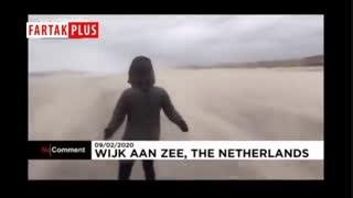 مقاومت یک فرد در مقابل تندباد سیارا در ساحل هلند